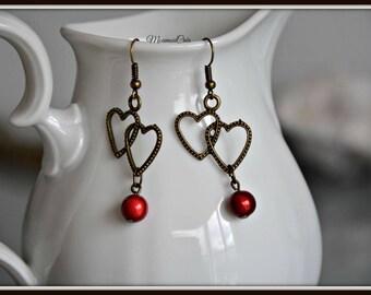 Bronze heart earrings entwined.
