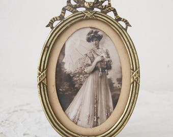 Antique Brass Oval Photo Frame with Bow Decor, Footed French Photo Frame