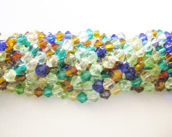 Beads bicone faceted glass 4x5mm x 80