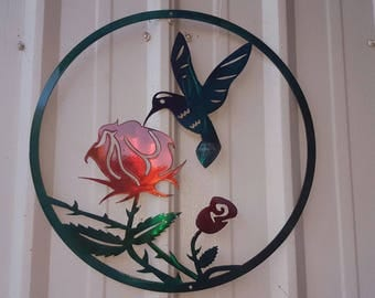 20 inch diameter humming bird colored wall hanger painted and clear coated