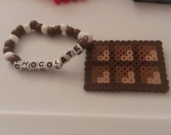 Chocolate perler on a kandi bracelet