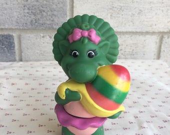 Vintage Baby bop vinyl figure, 1997 Barney's Baby Bop with TuTu holding Magical Egg toy