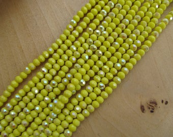 Set of 50 beads shaped 6 x 4 mm faceted glass: lemon yellow.