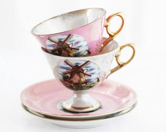 Pair of two(2)Teacups and Saucers, lusterware, Versailles style, goldcolor décor and windmills, iridescent pink and white to grey-blue base.