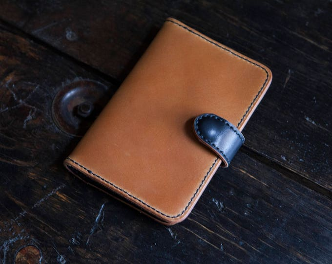 Whiskey and Black Shell Cordovan Travel Wallet. Handstitched with Snap Closure.