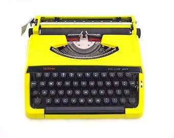 SALE!* Brother deluxe 220 typewriter, brother typewriter, poison green, green, yellow, in working state, portable typewriter, vintage.