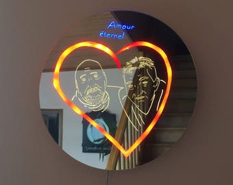 Frame carved mirror bright, eternal love.