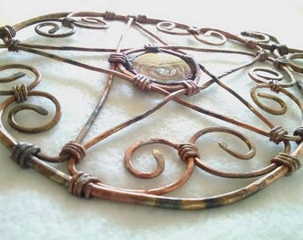 Copper altar pentacle trivet with a lampwork borosilicate glass spiral center piece
