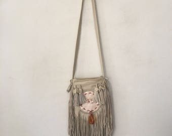 Real handmade crossbody bag from soft leather with elements of fashionable leather fringe with amber new women's beige with pink size-small.