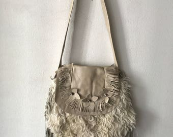 Sheepskin fur hand made woman bag .
