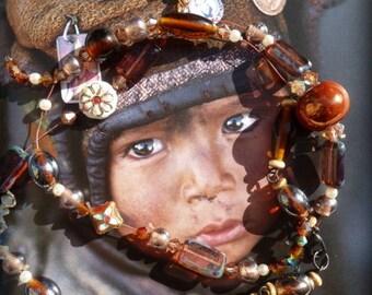 chestnut brown Kahzakstan half long necklace
