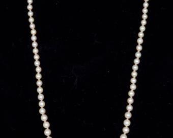 "Vintage Matinee length cultured Pearls 21.0""  Gemologist appraised value 1405.00"