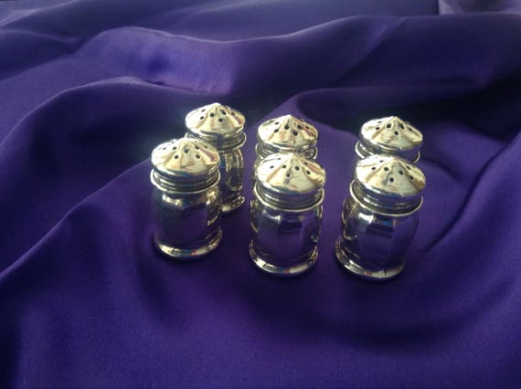 Six Sterling Silver individual salt or pepper shakers.