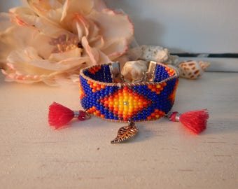 Ethnic bracelet with seed beads, leather, journal and tassels