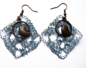 Crocheted metal bird motif earrings