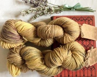 Grungy summer: gold yarn with coloured flecks. Merino 4ply.