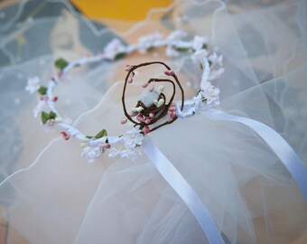 With its beaded veil bridal wreath