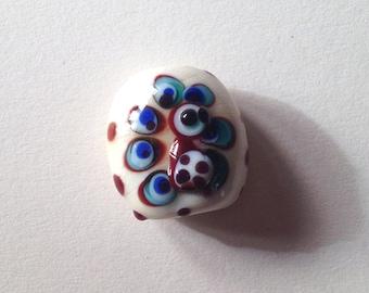 Hand spun glass bead.