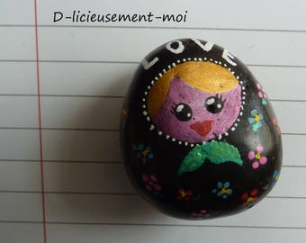 Magnet magnet Pebble handpainted depicting a matryoshka nesting doll with inscription Love