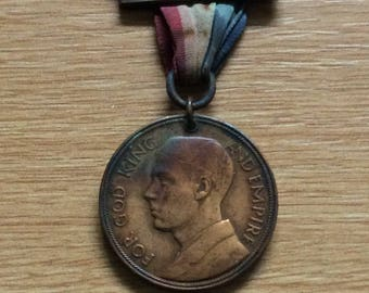 British Empire Day Medal made of Bronze with 2 Bars dated 1931 and 1932.