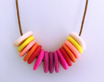 handmade polymer clay ombre beaded necklace, creams, yellows pinks and reds , hand-formed not so even beads
