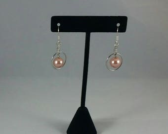 Peach colored pearls on silver hoops