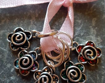 5 Knitting stitch markers. Silver flowers