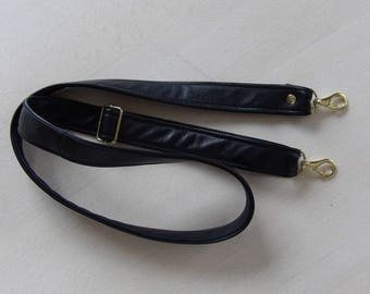 Black leather shoulder strap