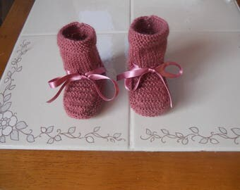 hand-knitted old pink slippers