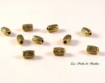 Set of 4 mm - ref:z475 7.5x7 - gold - patterned Tube shaped metal beads