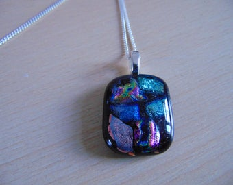 Mosaic pendant of fused dichroic glass rainbow on black