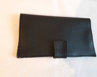 Fabric checkbook and black faux leather