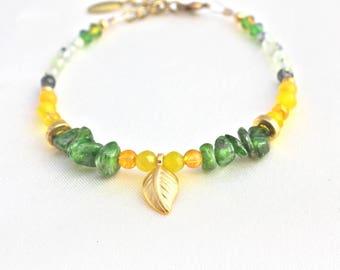 Bracelet gold plated, Swarovski crystals and gemstones: tsavorite, perhnite and jade