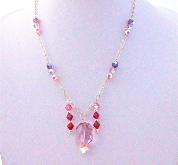 wedding necklace with swarovski cabochon, beads ans faceted beads and a siver 925 rolo chain