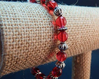 red beaded bracelet 7 1/2 in