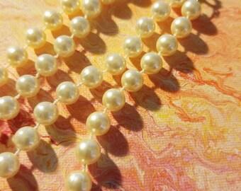 3 piece set pearls bracelet and 2 necklaces strands.