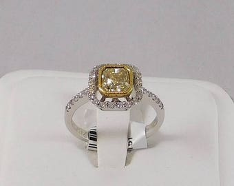 Fancy Yellow Diamond Engagement Ring. Center is 1Carat in Size & Set in 18k Gold