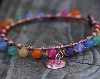 "Hand Stamped and wire wrapped, Copper Rainbow Bangle Bracelet. This one says: ""Love"". Copper and semiprecious stone beads, handmade."