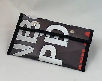 Pencil/cosmetic case black grey and red lettering