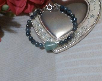 Handmade genuine tanzanite and emerald bracelet in sterling silver.