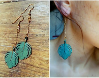 Earrings chains and green grey feathers