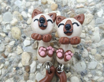 fimo earrings depicting a cat