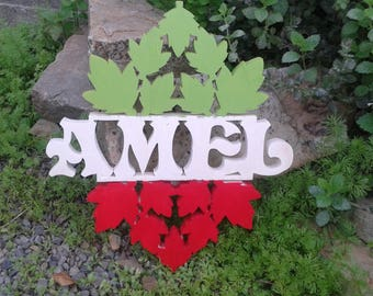 Your personalized name in wood with personalized design.