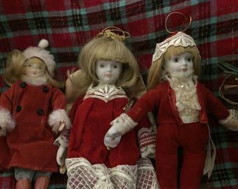 Trio of vintage bone china Christmas doll ornaments