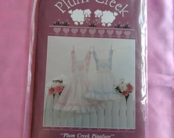 Plum Creek Pinafore Pattern. Heart Straps. Girls sizes 2-3 and 4-5. NOS. NIP.