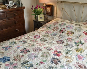 Delightful hand made, vintage, patchwork quilt in the flower design, double bed size.