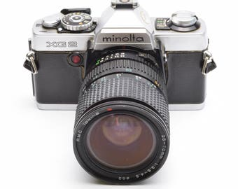 Minolta XG2 35mm SLR Camera with RMC Tokina 28-70mm f/3.5-4.5 Lens c. 1977