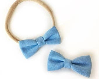 Mini Size Blue Classic Hair Bow Attached to your choice of a Nylon Headband or Alligator Clip