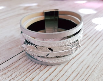 Silver mutlirang and silver feather bracelet