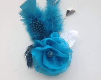 Blue flower and feather fascinator